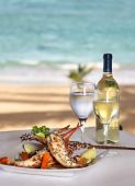 a white  plate of wonderful lobster aver many vegetables poster