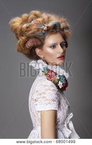 Updo. Dyed Hair. Woman with Modern Hairstyle. High Fashion poster