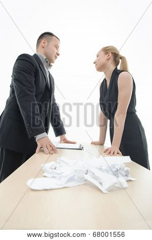 Colleagues discussing something with a heap of paper