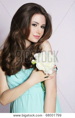 Modesty. Humble Young Woman With Peony Flower