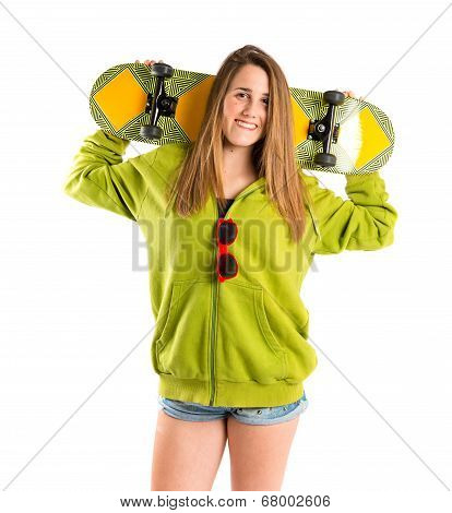 Blonde Girl With Skate Over White Background