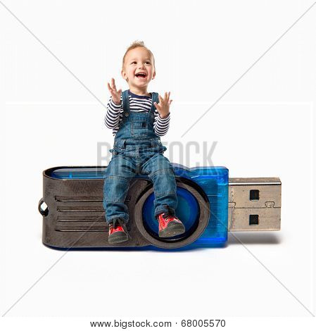 Kid On Pendrive Over White Background