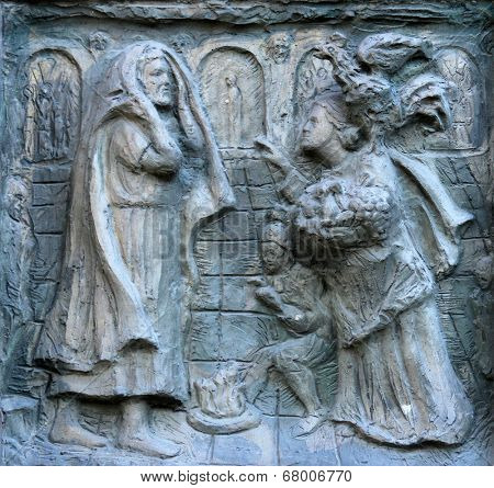 PARIS, NOV 9, 2012: Detail of the door. Church of St. Peter in Montmartre, according to the earliest biography of Saint Ignatius Loyola, the church is a place of establishment of the Society of Jesus