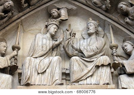 PARIS,FRANCE - NOV 05,2012:Coronation of the Virgin,architectural detail of Notre Dame cathedral.The Portal of the Virgin, dedicated to the patroness of the cathedral, was sculpted in the 1210s-1220s.