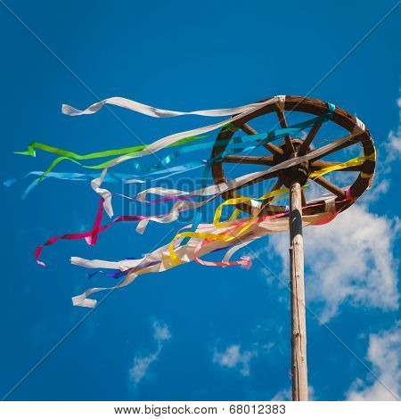 Celebration Of Midsummer. Wooden Wheel With Bright Ribbons