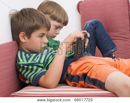 boys playing video games on the tablet computers