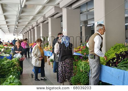 MARMARIS, TURKEY - MAY 1, 2014: People on the city farmer's market. Although the market works only one day per week, locals prefer to buy here due to cheaper prices and broader assortment
