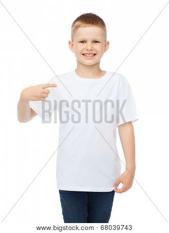 t-shirt design and advertisement concept - smiling little boy in blank white t-shirt pointing at herself