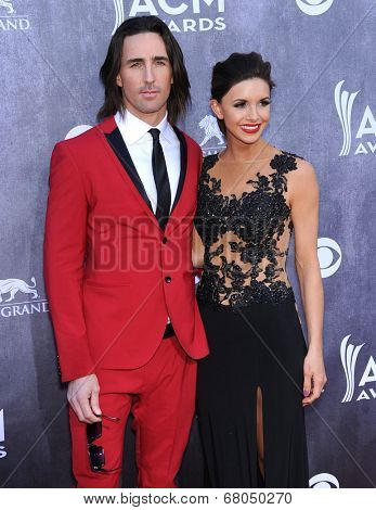 LOS ANGELES - APR 06:  Jake Owen & Lacey Buchanan arrives to the 49th Annual Academy of Country Music Awards   on April 06, 2014 in Las Vegas, NV.