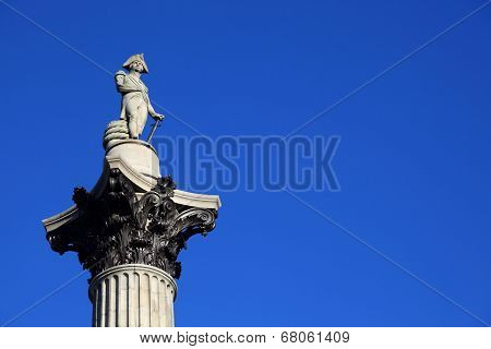 Nelson's Column monument rises to nearly 185 feet in the centre of Trafalgar Square London England it was erected to celebrate Horatio Nelson's great victory at Trafalgar over Napoleon in 1805 poster