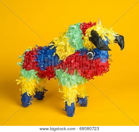 A mexican torro pinata  a yellow background
