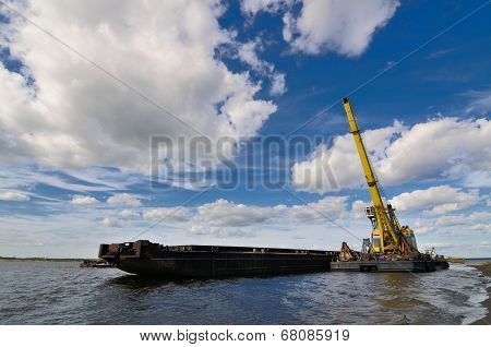 Port crane and barge