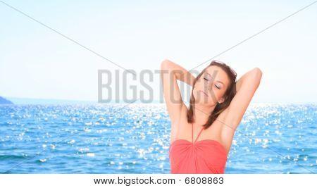 Beautiful Young Woman Relaxing By The Beach