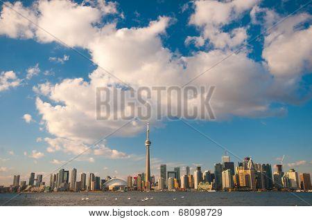 View of Toronto skyline with blue sky over Ontario lake