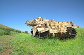 Destroyed rusty Centurion Shot Kal tank on Golan Heights. HDR photo. poster