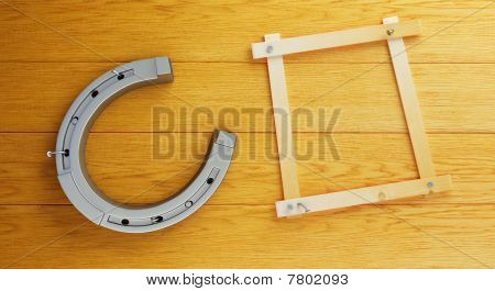 horseshoe nailed to wooden boards