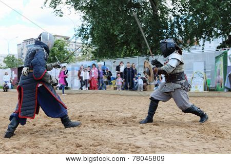 Perm, Russia - June 25, 2014: Fencer On Left With Two Rapiers And Fencer On Right With Shield Fight