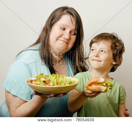 fat woman holding salad and little cute boy with hamburger teasing real family poster