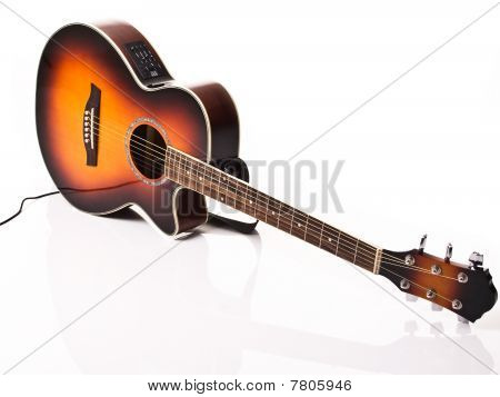 Acoustic and electric guitar with white and power cable