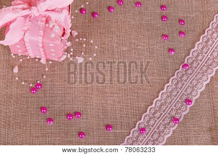 Background Of Burlap With Pink Git Box And Pink Lace