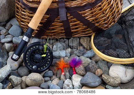 Fishing Equipment On River Bed Stones