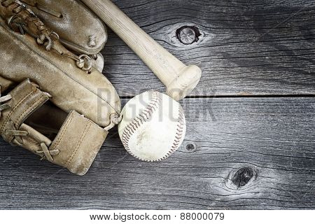 Used Baseball Equipment On Rustic Wood