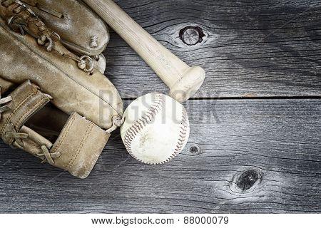 Used Baseball Equipment On Rustic Wood