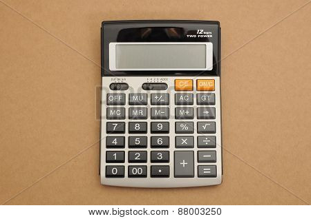 Closed-up calculator on brown background