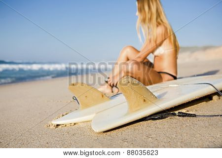 Beautiful woman on the beach getting ready for surf