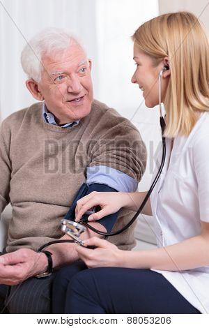 Nurse Measuring Blood Pressure