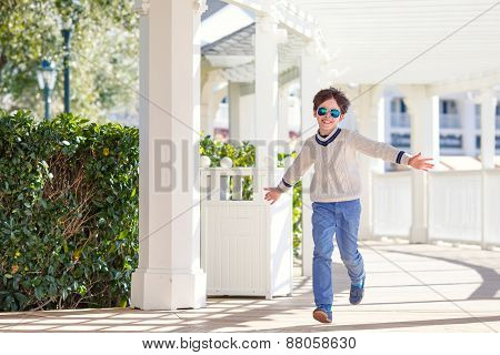 Cheerful little boy having fun outdoors