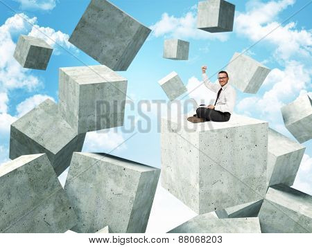smiling businessman on 3d concrete abstract cubes
