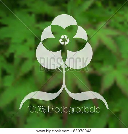 Eco friendly tree design against blurred green leafy background.