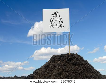 Mole mound with white flag showing mole icon affixed over blue sky poster
