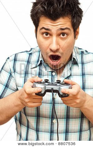 Young Man With A Joystick Playing Video Games