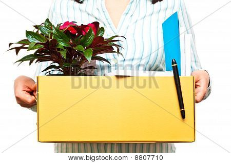 Woman In A Shirt Holding A Box With Her Belongings After Being Hired / Fired