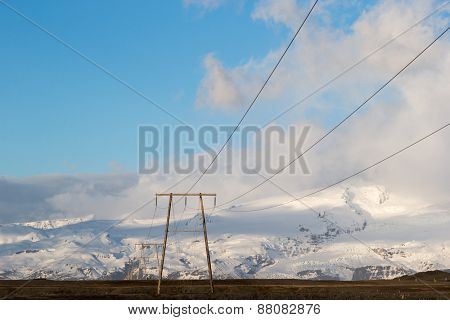 Power lines and electricity pylons and towers stretch across Iceland supplying ecologically friendly electricity sourced from geothermal energy from deep in the ground.