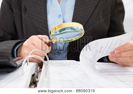 Businessperson Checking Bills