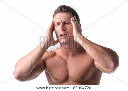 Muscular handsome man holding his head with one hand and grimacing in pain for headache, isolated on white poster