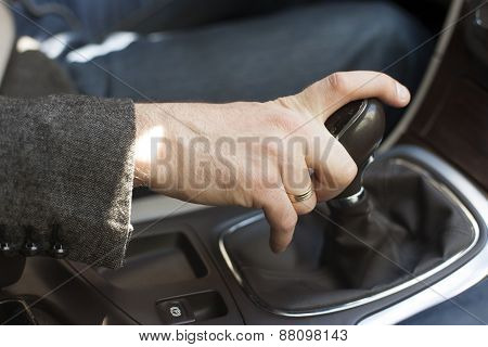 Car interior elegant man hand on a gear shift lever poster