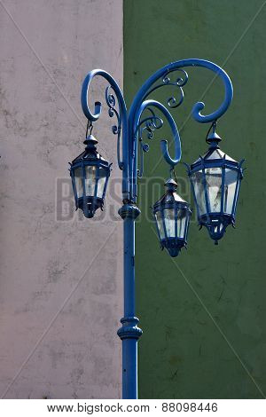 Blue Street Lamp  And A Green White  Wall