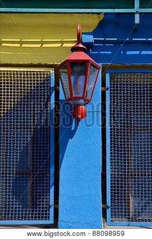 Red Street Lamp  And A Yellow Blue Wall  In La Boca