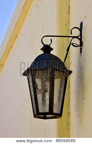 Street Lamp  And A Yellow Wall
