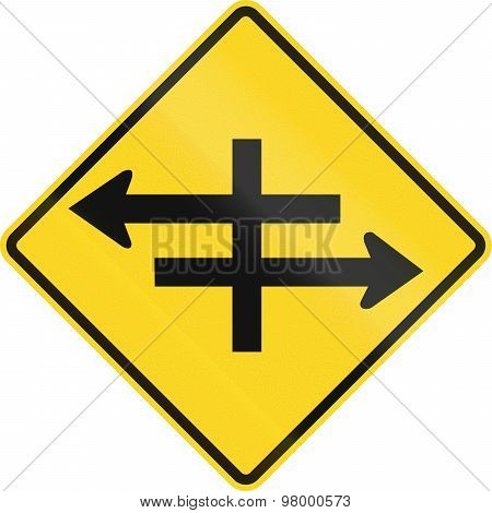 An Canadian warning traffic sign - Intersection at dual carriageway. This sign is used in Ontario. poster