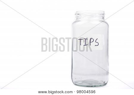An empty glass jar with a lable reading tips poster