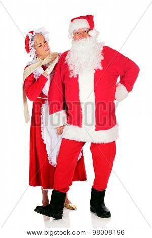 Mrs. Santa inspecting her husband before he takes off on his midnight flight.  On a white background.