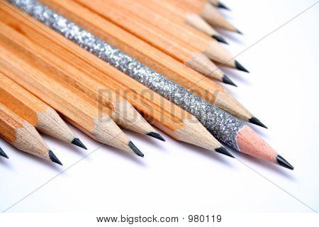 Celebratory Pencil Among Usual Pencils On A Diagonal