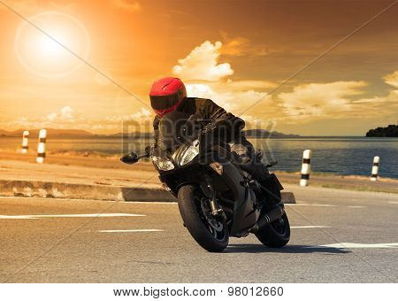 Young Man Riding Big Bike Motorcycle Against Sharp Curve Of Asphalt High Ways Road With Rural Lake S