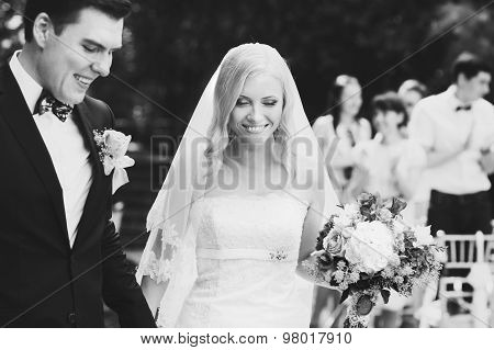 happy just married bride and groom walck after vedding ceremony black and white poster