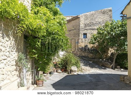 Houses And Flowers In An Old Village In South Europe